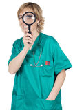 Doctor with magnifying glass Stock Image