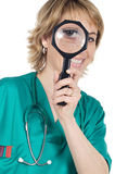 Doctor with magnifying glass Royalty Free Stock Photography