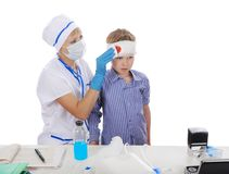 Doctor makes a bandage Royalty Free Stock Image