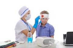 Doctor makes a bandage to the patient. Stock Image