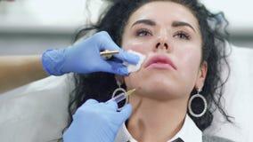 Doctor makes facial botox injection