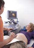 Doctor makes ultrasonic scan Stock Photos