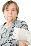 The doctor makes vaccination an old woman. On a white background Stock Images