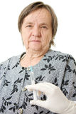 The doctor makes vaccination an old woman stock photo