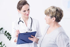 Doctor making the anamnesis with elder woman Stock Photo