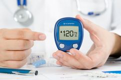 Doctor making blood sugar test. Healthcare, diabetes, medical co Stock Photo