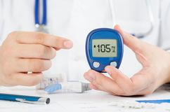 Doctor making blood sugar test. Healthcare, diabetes, medical concept Stock Photo