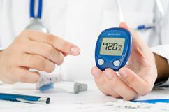 Doctor making blood sugar test. Healthcare, diabetes, medical concept Royalty Free Stock Image