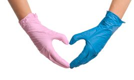Doctor making heart with hands in different medical gloves stock image