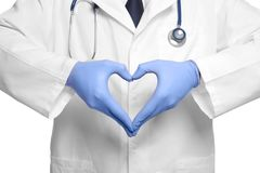 Doctor making heart with his hands on background Stock Image
