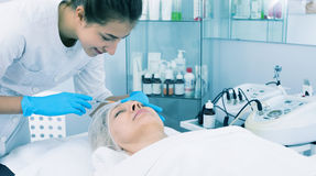 Doctor making injection royalty free stock photography