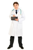 Doctor making notes in medical chart Royalty Free Stock Photos