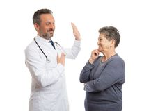 Doctor making oath with patient looking royalty free stock photos