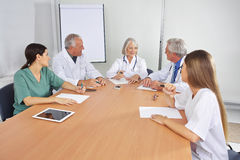 Doctor making schedule in team meeting royalty free stock photo