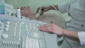 Doctor making ultrasonography thyroid men close-up 2 stock video footage