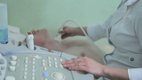 Doctor making ultrasonography thyroid men close-up. Doctor using the ECHO ultrasonography Full HD stock video footage