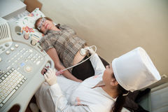 Doctor making ultrasound investigation Stock Photo