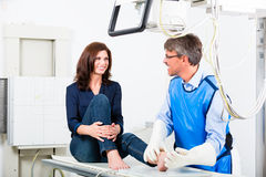 Doctor making x-ray of patient leg in surgery Royalty Free Stock Photo