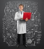 Doctor male in suit with laptop in his hands. Male doctor in suit with laptop in his hands, looking on camera Stock Photo