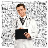 Doctor Man With Clipboard. Doctor man writing something with marker on glass Stock Photo