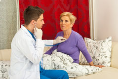 Doctor man examine senior woman home Stock Photo