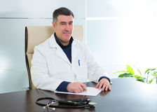 Doctor man sitting in hospital office desk portrait Royalty Free Stock Image