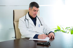 Doctor man sitting in hospital office desk portrait Royalty Free Stock Photography