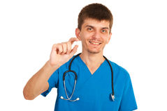 Doctor man giving pill Royalty Free Stock Images