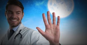 Doctor man holding hand open with moon. Digital composite of Doctor man holding hand open with moon Stock Photo