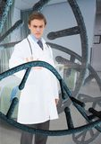 Doctor man interacting with 3D DNA strands. Digital composite of Doctor man interacting with 3D DNA strands Stock Image