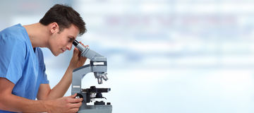 Doctor man with microscope. Stock Images