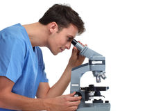Doctor man with microscope. royalty free stock image