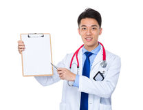 Doctor man pen point to the blank page on clipboard Stock Image