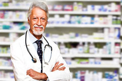Doctor man in the pharmacy Royalty Free Stock Images