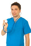 Doctor man showing stethoscope Royalty Free Stock Image