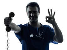 Doctor man silhouette holding phone gesture Stock Photo