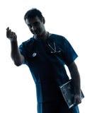 Doctor man silhouette portrait gesturing money Stock Photos