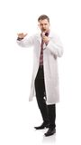 Doctor man with stethoscope. Smiling medical doctor man with stethoscope. Isolated on white background Stock Image