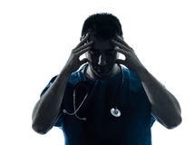 Doctor man tired headache silhouette portrait Stock Images