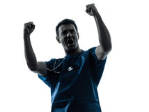 Doctor man triumphant silhouette portrait. One caucasian man doctor surgeon medical worker happy gesturing success silhouette isolated on white background Royalty Free Stock Image