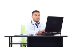 Doctor man typing on laptop in office Stock Images