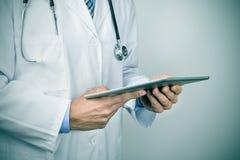 Doctor man using a tablet computer Stock Photos
