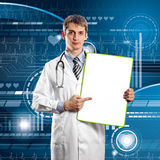 Doctor Man With Write Board. In his hands Royalty Free Stock Photo