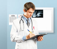 Doctor Man With Write Board. Doctor man with stethoscope and clipboard in his hands Royalty Free Stock Image