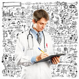 Doctor Man With Write Board. Doctor man with stethoscope and clipboard in his hands Stock Photography