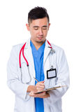 Doctor man write on clipboard Stock Photography