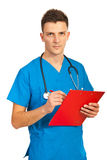 Doctor man writing in clipboard Royalty Free Stock Photo