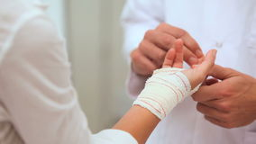 Doctor manipulating fingers of a patient stock footage