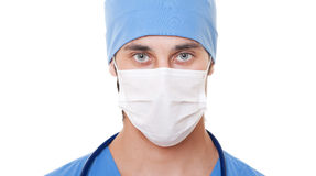 Doctor in mask. Portrait of doctor in mask and blue uniform. isolated on white background Stock Photography