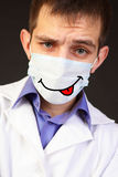 Doctor in a mask. Portrait of the doctor in a mask against a dark background Stock Images